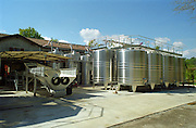 Stainless steel fermentation tanks at Chateau Giscours outside the winery building in free air. To the left the reception area for harvested grapes Margaux Medoc Bordeaux Gironde Aquitaine France Europe