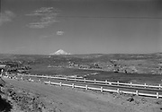 9305-A4603-1. Mt. Hood, Columbia River Highway & Columbia River looking west. Dalles Dam under construction, about 1952