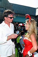 Jul 09, 2002; Los Angeles, CA, USA; ABC Channel 7 Eyewitness News anchor BILL WIER interviews a playmate for the evening news @ SUGAR RAY LEONARD BOXING first year anniversary which was celebrated with a live fight night on ESPN2 from the Playboy Mansion in Holmby Hills.  Over 350 invited guests attended the cocktail reception and showdown in the back yard of Playboy HUGH HEFNER's 5.5 acre estate. <br />Mandatory Credit: Photo by Shelly Castellano/ZUMA Press.<br />(©) Copyright 2002 by Shelly Castellano