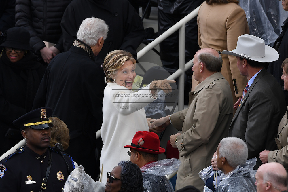 Former Democratic Presidential candidate Hillary Rodham Clinton waves as she and former President Bill Clinton depart following the President Inaugural Ceremony on Capitol Hill January 20, 2017 in Washington, DC. Donald Trump became the 45th President of the United States in the ceremony.
