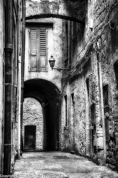 This is a back alley in a small Italian village. I had just finished lunch and dark storm clouds began forming overhead. Most people started heading for cover however I happened to see this alley and couldn't resist getting a few photos, even if it meant getting soaked (which is exactly what happened)