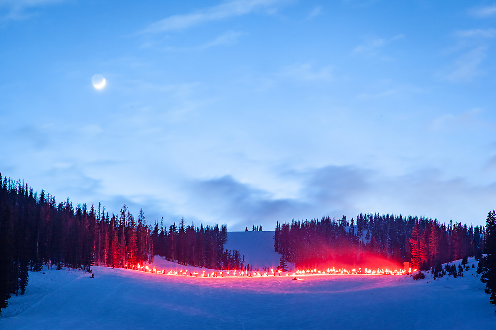Skier and riders carry torches down Freeway on New Year's Eve at Monarch Mountain.