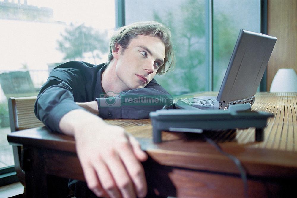 Dec. 05, 2012 - Man on laptop at home (Credit Image: © Image Source/ZUMAPRESS.com)
