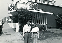 1957 A couple stands in front of Ciro's Nightclub on Sunset Blvd.