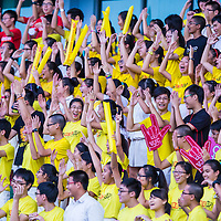 Supporters cheer during the final of the National 'A' Division Football Championship between Victoria Junior College and Raffles Institution at Jalan Besar Stadium on May 19, 2014, in Singapore.
