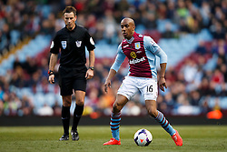 Aston Villa Midfielder Fabian Delph (ENG) in action as referee Mark Clattenburg looks on - Photo mandatory by-line: Rogan Thomson/JMP - 07966 386802 - 23/03/2014 - SPORT - FOOTBALL - Villa Park, Birmingham - Aston Villa v Stoke City - Barclays Premier League.