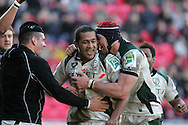 Chris Hala'ufia of London (c) celebrates with teammate Nick Kennedy (r) after he  scores a try. Heineken cup rugby, Scarlets v London Irish at the Parc y Scarlets stadium in Llanelli on Sunday 17th Jan 2010.  pic by  Andrew Orchard  , Andrew Orchard sports photography,