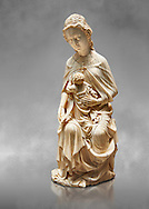 """Medieval Gothic ivory statuette of the Virgin and Child known as """"a La Supplique"""" (supplication) made in Paris oat the beginning of the the 15th century.  inv 2745, The Louvre Museum, Paris. .<br /> <br /> If you prefer you can also buy from our ALAMY PHOTO LIBRARY  Collection visit : https://www.alamy.com/portfolio/paul-williams-funkystock/gothic-art-antiquities.html  Type -   louvre     - into the LOWER SEARCH WITHIN GALLERY box. Refine search by adding background colour, place, museum etc<br /> <br /> Visit our MEDIEVAL ART PHOTO COLLECTIONS for more   photos  to download or buy as prints https://funkystock.photoshelter.com/gallery-collection/Medieval-Gothic-Art-Antiquities-Historic-Sites-Pictures-Images-of/C0000gZ8POl_DCqE"""