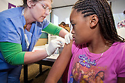 """Oct. 24, 2009 - SCOTTSDALE, AZ: ERICA MILTON, 12, from Surprise, AZ, was the first to get an H1N1 vaccination at Scottsdale Healthcare's Community Health Services clinic Saturday morning. JENNI JONES, RN, administered her shot. The first publicly administered H1N1 (""""swine flu"""") vaccinations were given in the Phoenix area Saturday. About 52,000 doses of the vaccine, in both injection and nasal spray form, were available on a first come first served basis, but only to those in so called """"high risk"""" groups: pregnant women, children 6 months to 4 years old, children 5 years to 18 years with underlying health concerns and direct caregivers of infants less than 6 months old. More than 700 people lined up at Scottsdale Health Care, which had 500 doses of the vaccine to administer.     Photo by Jack Kurtz"""