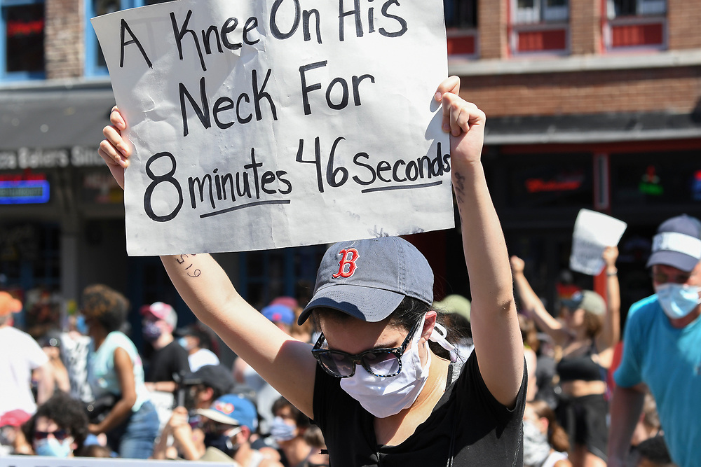 A protester holds up a sign showing how long it took for George Floyd to die during the March and Vigil for George Floyd on June 6, 2020 in Nashville, TN