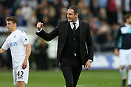 Paul Clement, the Swansea city manager © shows his relief as he celebrates on the pitch at full-time after his team win the match 1-0. Premier league match, Swansea city v Everton at the Liberty Stadium in Swansea, South Wales on Saturday 6th May 2017.<br /> pic by  Andrew Orchard, Andrew Orchard sports photography.