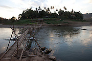 Bamboo bridge across the Nam Khan River, Luang Prabang, Laos.