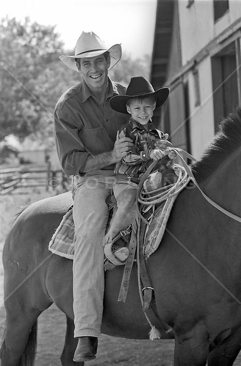 cowboy and small boy on a horse at a ranch in New Mexico