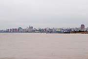A view of the city skyline over the river Rio de la Plata on a grey and overcast winter day. Montevideo, Uruguay, South America