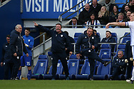 Cardiff city manager Neil Warnock ® reacts on the touchline as he is furious with a 2nd half decision from the referee  Peter Bankes where Cardiff should have had a penalty after Junior Hoilett had been brought down in the area but the referee doesn't give it.  EFL Skybet championship match, Cardiff city v Birmingham City at the Cardiff city stadium in Cardiff, South Wales on Saturday 10th March 2018.<br /> pic by Andrew Orchard, Andrew Orchard sports photography.