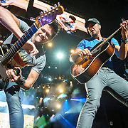 "BRISTOW, VA - May 30th 2014 - Guitarist Michael Carter and Luke Bryan trade guitar licks during a performance of Bryan's hit single ""Rain Is A Good Thing,"" at Jiffy Lube Live in Bristow, VA. (Photo by Kyle Gustafson / For The Washington Post)"