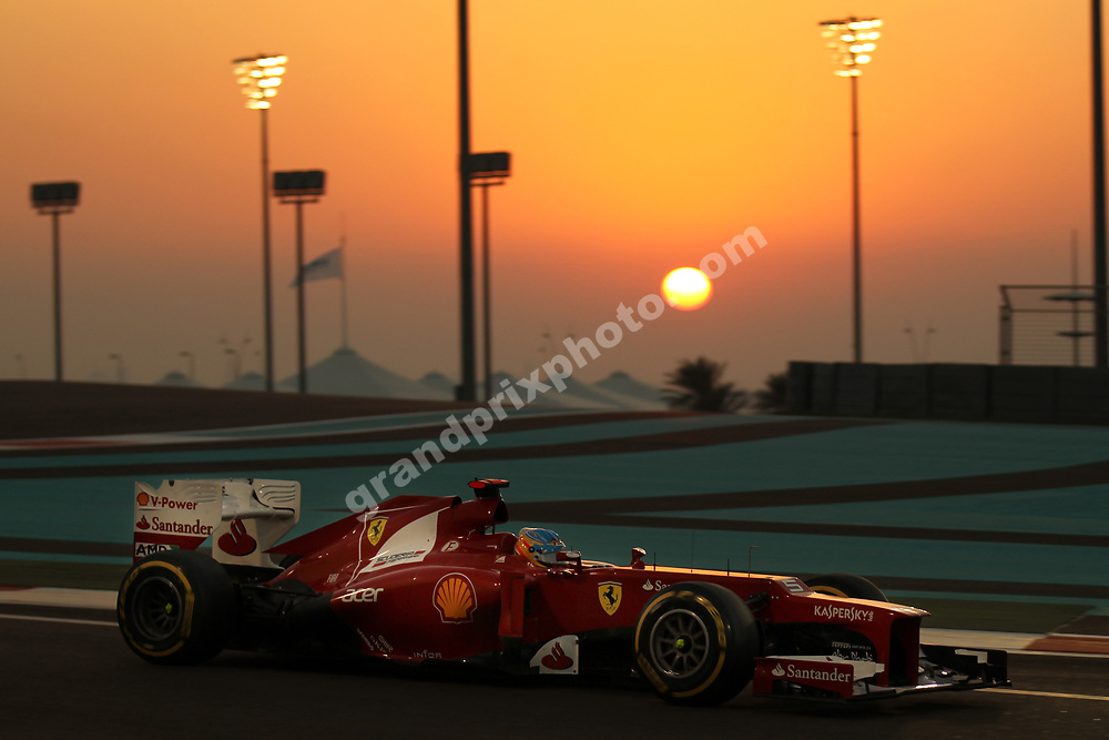 Fernando Alonso (Ferrari) in the sunset in the 2012 Abu Dhabi Grand Prix at Yas Marina circuit. Photo Grand Prix Photo