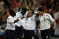 Photo: Rich Eaton.<br /> <br /> England v Russia. UEFA European Championships Qualifying. 12/09/2007. England's Michael Owen (2nd right) celebrates after scoring the opening goal of the game.