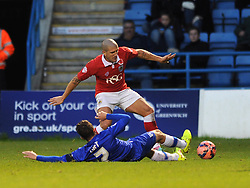 Bristol City's Adam El-Abd is challenged by Gillingham's Doug Loft - Photo mandatory by-line: Dougie Allward/JMP - Mobile: 07966 386802 - 08/11/2014 - SPORT - Football - Gillingham - Priestfield Stadium - Gillingham v Bristol City - FA Cup - Round One