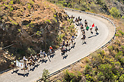 Hundreds of Mexican cowboys snake along the road up Cubilete Mountain on the final leg of the annual Cabalgata de Cristo Rey pilgrimage January 5, 2017 in Silao, Guanajuato, Mexico. Thousands of Mexican cowboys and horse take part in the three-day ride to the mountaintop shrine of Cristo Rey.