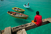 Santa Maria, Sal island, Cape Verde 2005 - The town's only pier is a battered but functional life line to the water for the fishermen and town's people of this island community.