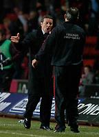 Photo: Alan Crowhurst.<br />Southampton v Milton Keynes Dons. The FA Cup.<br />07/01/2006. <br />Dons' coach Danny Wilson (L) congratulates George Burley on his victory.