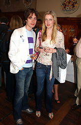 PETER HOBBS and EVA RICE daughter of Sir Tim Rice at a party to celebrate the publication of Wicked - A Tale of Two Schools by Jilly Cooper held at Westminster School, Dean's Yard, London on 11th May 2006.<br /><br />NON EXCLUSIVE - WORLD RIGHTS