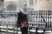 A woman wearing a bobble hat walks near the Tower of London during snow fall in London, England on March 2nd, 2018 as freezing weather, dubbed the Beast from the East combined with Storm Emma have brought snow and freezing weather to the UK.