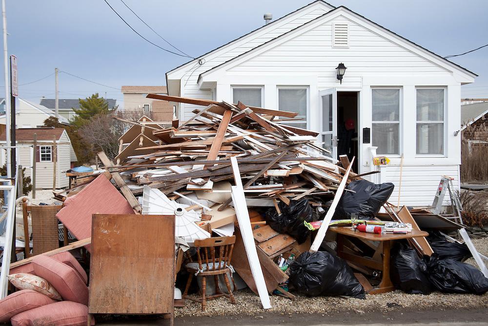 The entire contents of a home piled high curbside, all too common a sighs in flooded regions of the Jersey shore.