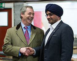 © Licensed to London News Pictures . 23/03/2015 . Middleton , UK . Nigel Farage meets a UKIP supporter at the factory . UKIP leader Nigel Farage , Deputy Leader Paul Nuttall and Economics Spokesman Patrick O'Flynn announce UKIP's economic policy at Concept Metal Products and Co Ltd in Middleton , Lancashire . Photo credit : Joel Goodman/LNP