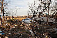Union Beach NJ, November 16, Car burried under a roof of a  destroyed  home by superstorm Sandy's surge, that damaged over 200 homes in Union Beach alone. Hurricane Sandy's strength is being blamed on climate change by many scientists.