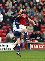 Photo: Dave Linney.<br />Walsall v Swindon Town. Coca Cola League 2. 09/12/2006.<br />Walsall's Ian Roper(R) climbes highest to beat   Lucas Jutkiewicz to the ball.