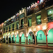 Brightly colored lights decorate the outside of Valladolid's town hall next the main square. Valladolid is a Spanish colonial town in the middle of Mexico's Yucatan Peninsula.