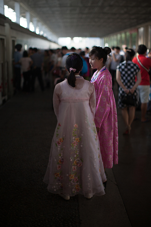 Young women in traditional Korean dress at the Pyongyang railway station.