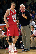 Texas Tech head coach Bobby Knight (R) gives some instructions to Red Raider Damir Suljagic during the second half, in a game against Kansas State at Bramlage Coliseum in Manhattan, Kansas, January 8, 2007.  Texas Tech defeated K-State 62-52.
