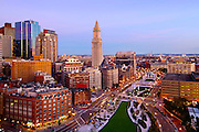 Downtown Boston at sunrise with the Custom House and the new Rose Kennedy Greenway.