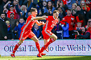 Wales midfielder Daniel James scores and celebrates a goal 1-0 during the UEFA European 2020 Qualifier match between Wales and Slovakia at the Cardiff City Stadium, Cardiff, Wales on 24 March 2019.