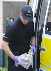 © Licensed to London News Pictures. 12/09/2013 A police officer carrying evidence in a bag. Police Raid a property in Stone, Dartford in connection with Claire Tiltman MURDER 20 YEARS AGO. Miss Tiltman was stabbed to death in an alleyway off the A226 London Road in Greenhithe, four days after her 16th birthday in 1993. Photo credit :Grant Falvey/LNP