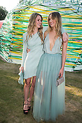 Immy Waterhouse; Suki Waterhouse, Serpentine's Summer party co-hosted with Christopher Kane. 15th Serpentine Pavilion designed by Spanish architects Selgascano. Kensington Gardens. London. 2 July 2015.