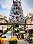 06 JUNE 2015 - KUALA LUMPUR, MALAYSIA: The main entrance to Sri Mahamariamman Temple, the oldest functioning and most important Hindu temple in Malaysia. The principal deity in the temple is Mariamman,  a deity that is popularly worshipped by overseas Indians, especially Tamils, because she is looked upon as their protector during the sojourn to foreign lands. Mariamman is a manifestation of the goddess Parvati, an incarnation embodying Mother Earth with all her terrifying force. She is associated with disease and fever and protects her devotees from unholy or demonic events.     PHOTO BY JACK KURTZ