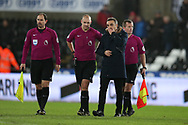 Swansea city manager Carlos Carvalhal has a long chat with referee Bobby Madley and his assistants at the final whistle. Premier league match, Swansea city v Tottenham Hotspur at the Liberty Stadium in Swansea, South Wales on Tuesday 2nd January 2018. <br /> pic by  Andrew Orchard, Andrew Orchard sports photography.