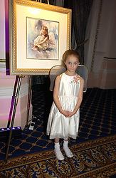 MISS CHLOE LUCAS at a reception to launch Angel themed Christmas Cards and view an exhibition of the original art work by Gordon King with proceeds going to the Caron Keating Foundation  held at the Langham Hotel, Portland Place, London on 20th November 2006.<br />