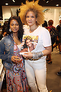 29 July 2010-New York, NY- l to r: Grace Anezia Ali (Of Note Magazine) and Michaela Angela Davis(Cultural Critic, Writer) at The H&M and Uptown Magazine Celebration of the grand re-opening of the H&M Harlem Store with a VIP preview with music, food and 25% off the evenings purchases held at H&M harlem on July 29, 2010 in Harlem, New York City. Photo Credit: Terrence Jennings