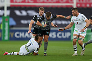Scott Otten of the Ospreys © is tackled by Alexandre Lapandry of Clermont Auvergne (l) .European Rugby Champions Cup, pool 2 match, Ospreys v ASM Clermont Auvergne at the Liberty Stadium in Swansea, South Wales on Sunday 15th October 2017.<br /> pic by  Andrew Orchard, Andrew Orchard sports photography.