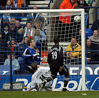 Photo. Jed Wee.<br /> Bolton Wanderers v Newcastle United, FA Barclaycard Premiership, Reebok Stadium, Bolton. 28/03/2004.<br /> Newcastle goalkeeper Shay Given, Bolton's Kevin Davies, and defender Titus Bramble (L to R) all fail to get to a looping Henrik Pedersen shot which gives Bolton the lead.