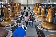 The destillery cobber tanks are the last leg of the making of the world famous Glenfiddich whisky. The distillery runs free tours, here the guide Lucy takes a group of whisky enthusiasts around the plant.