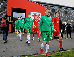 WREXHAM, WALES - Wednesday, October 30, 2019: Republic of Ireland's Corey McLoughlin (L) and Wales' Here Hewitt-White walk out before during the 2019 Victory Shield match between Wales and Republic of Ireland at Colliers Park. (Pic by David Rawcliffe/Propaganda)