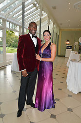 DEREK REDMAN and his wife MARIA at 'A Night of Champions' an evening to raise funds for the Mo Farah Foundation held at The Hurlingham Club, London on 28th August 2014.