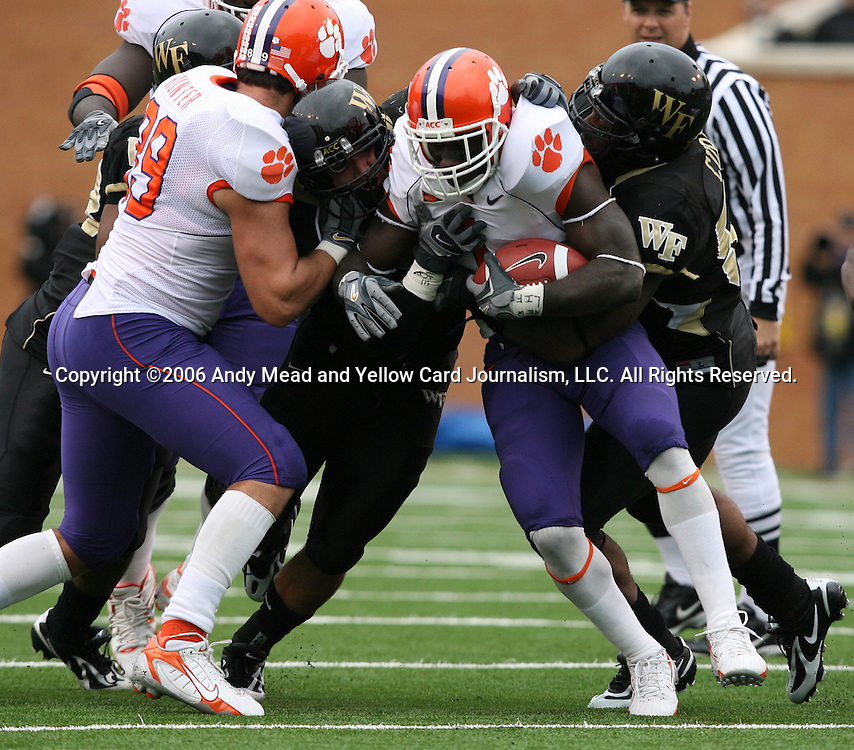 07 October 2006: Clemson's James Davis (2nd from right) rushes for two yards before being tackled by Wake Forest's Aaron Curry (right). The Clemson University Tigers defeated the Wake Forest University Demon Deacons 27-17 at Groves Stadium in Winston-Salem, North Carolina in an Atlantic Coast Conference NCAA Division I College Football game.