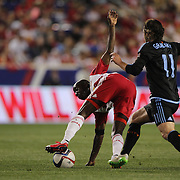 Bradley Wright-Phillips, New York Red Bulls, is challenged by Ned Grabavoy, NYCFC, during the New York Red Bulls Vs NYCFC, MLS regular season match at Red Bull Arena, Harrison, New Jersey. USA. 10th May 2015. Photo Tim Clayton